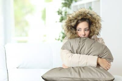 Bigstock Woman Warmly Clothed In A Cold 112935647 400x267 1